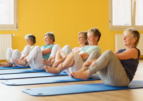 elderly people at a yoga class